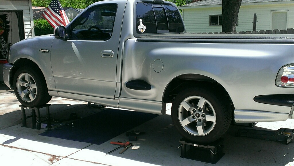 pickup truck on lift stands - great for at-home auto repair