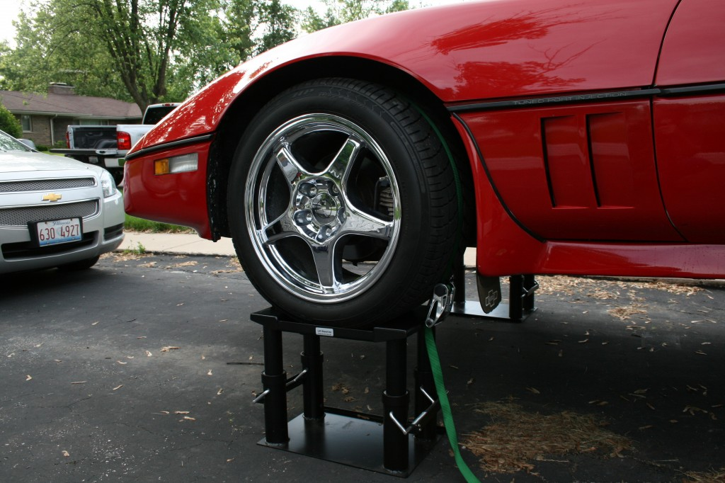 Close-up of Corvette tire resting in the top pan of the Lift Stand